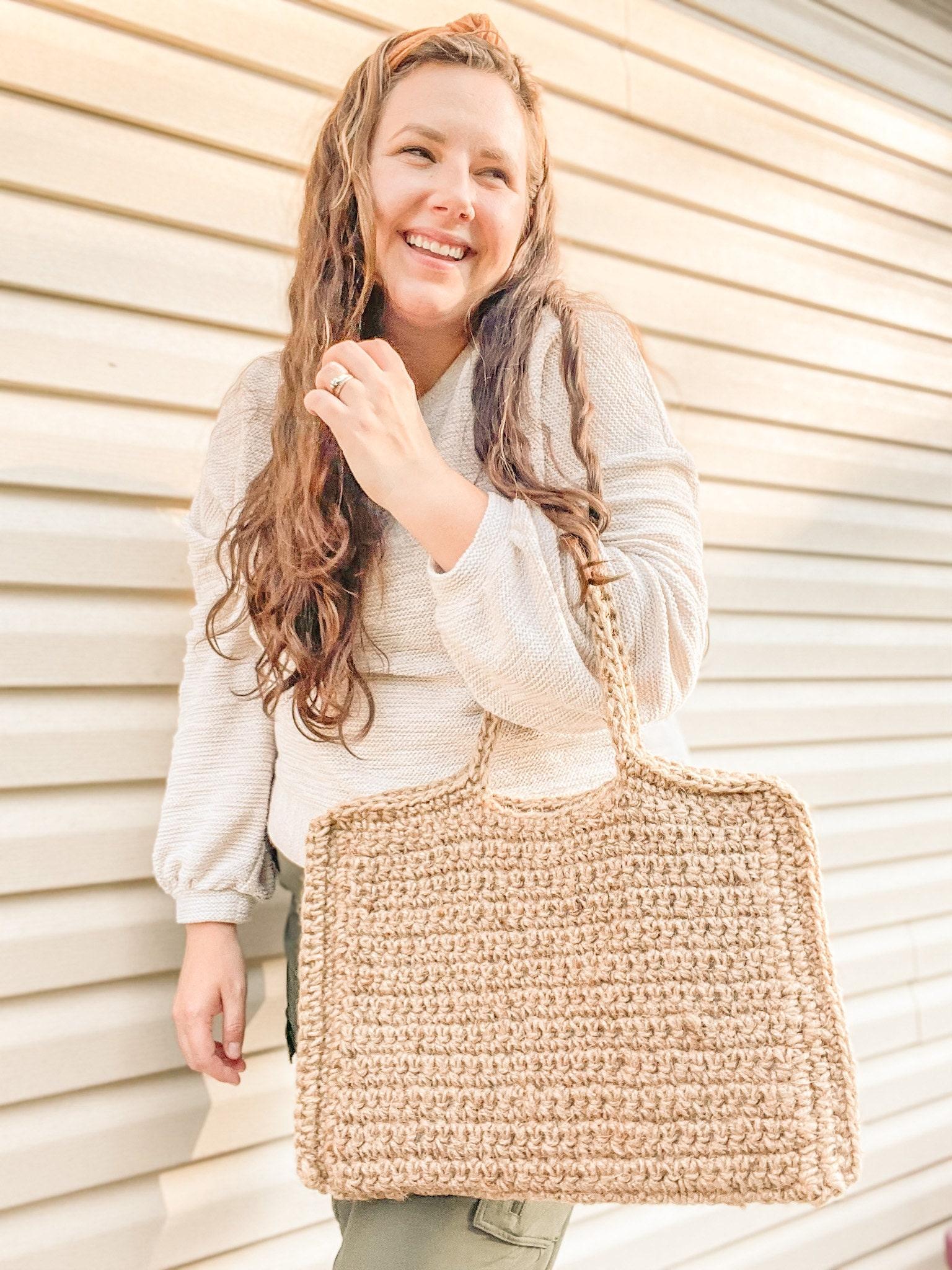 Woman carrying a crochet, jute laptop bag