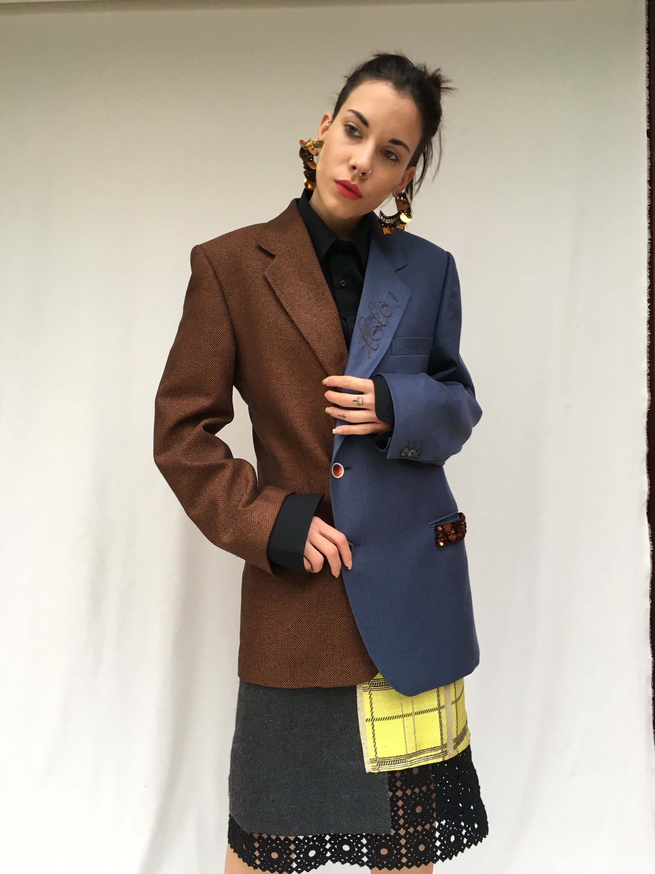 deconstructed skirt and jacket from selected vintage items. sustainability in the creative recovery of high quality waste clothing