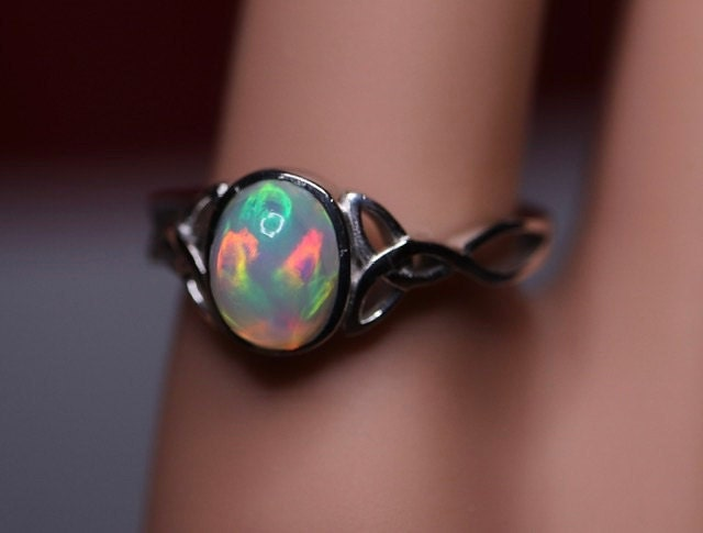 Celtic cabochon ring - perfectly made with a stunning opal and gorgeous ring setting plated with rhodium over sterling silver. Priced ridiculously low and you cannot find anything even remotely similar to this in quality anywhere that's not at least $700! Check out my price:)