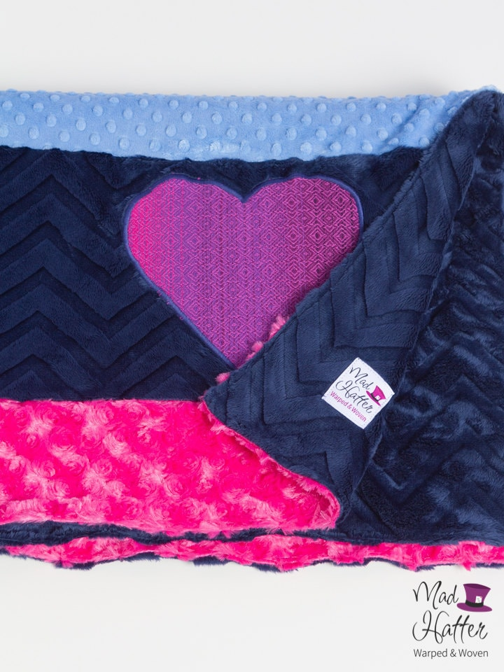 Mad Hatter Warped & Woven Minky Blanket with strips of hot pink, dark blue, and light blue minky and a wrap scrap heart.