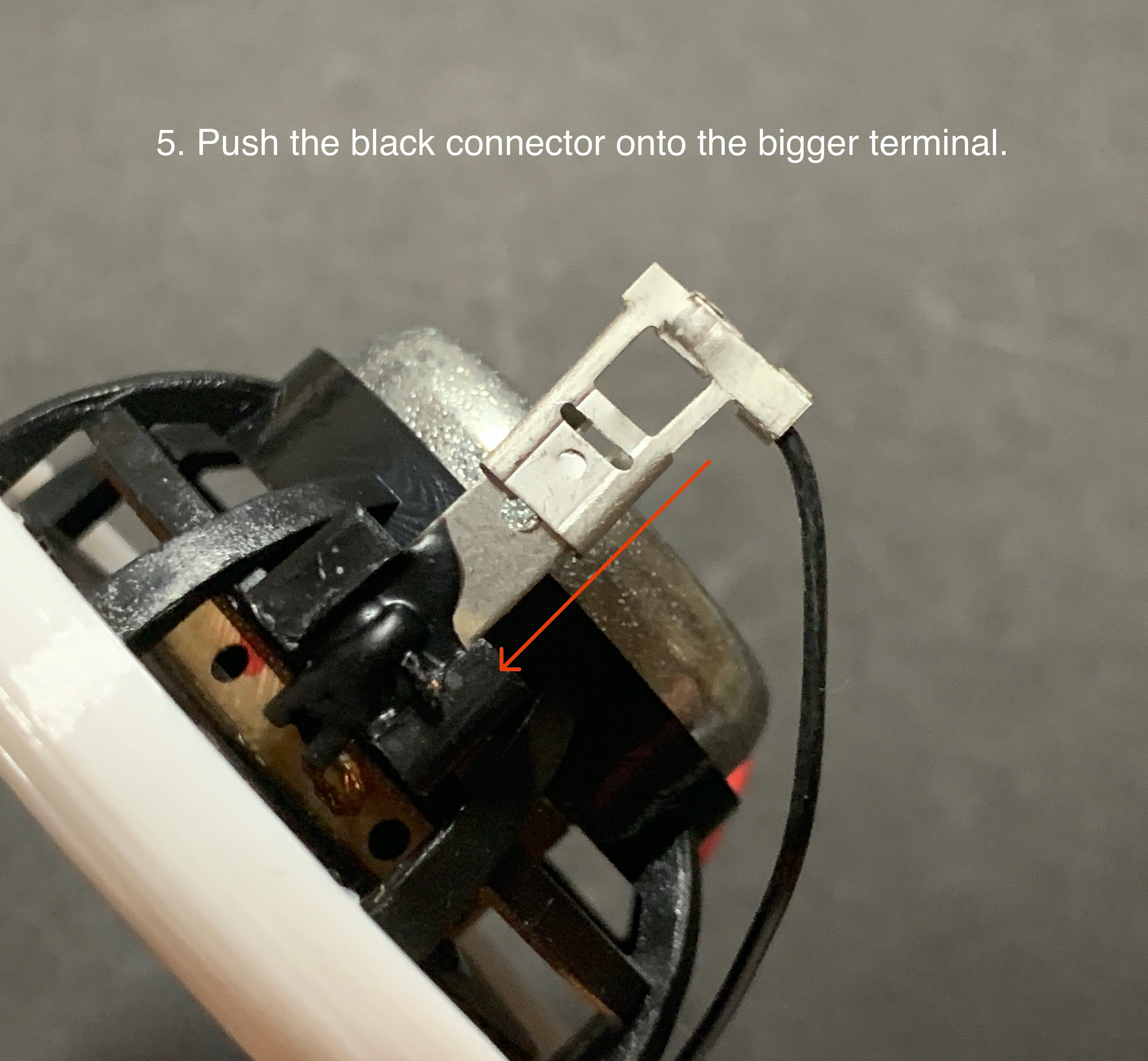 5. Push the black connector onto the bigger terminal.