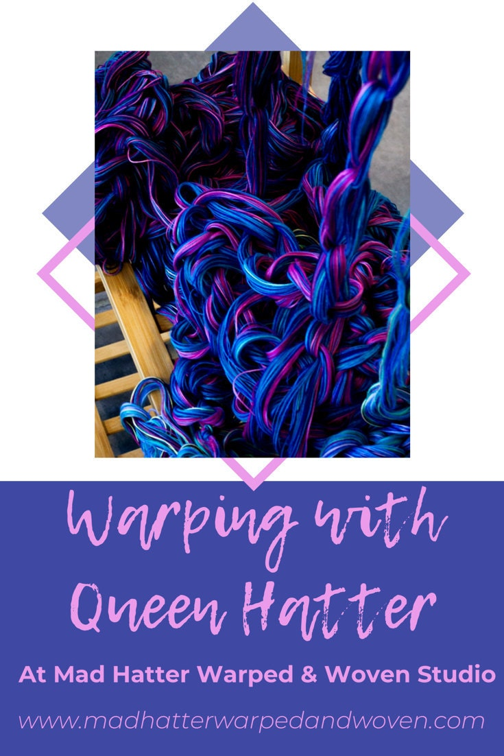 A graphic image with a photograph of chained yarn in blue, purple, and pink colours. There is a matching blue square at the bottom with pink text that reads Warping with Queen Hatter at Mad Hatter Warped & Woven Studio www.madhatterwarpedandwoven.com