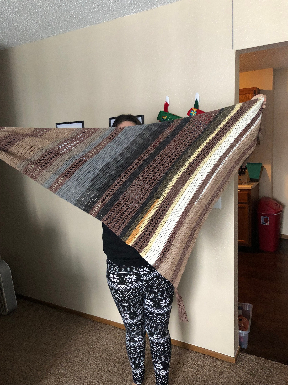 Woman holding crochet scarf