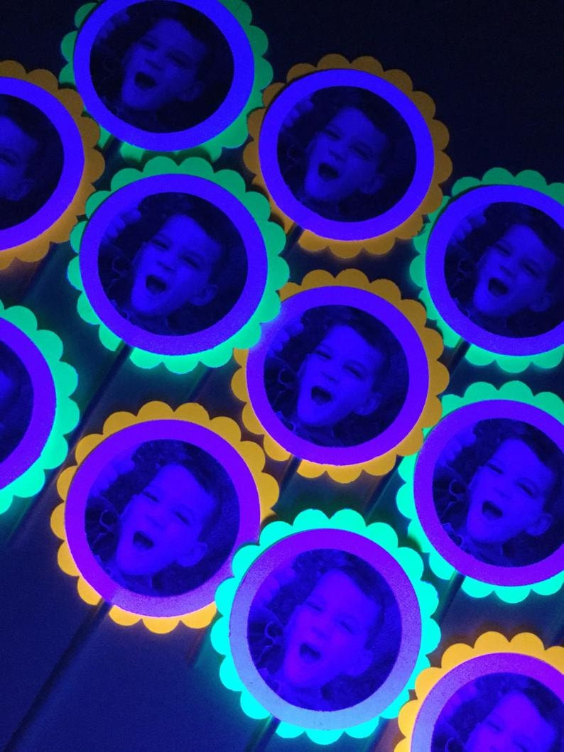 fluorescent neon cupcake toppers with picture of boy