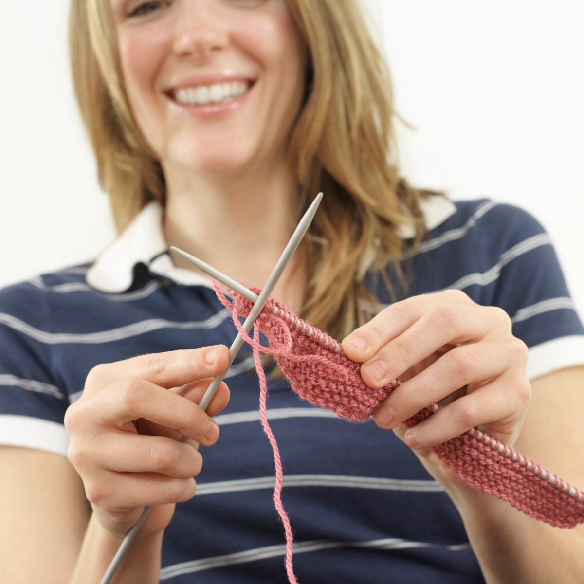 woman is knitting