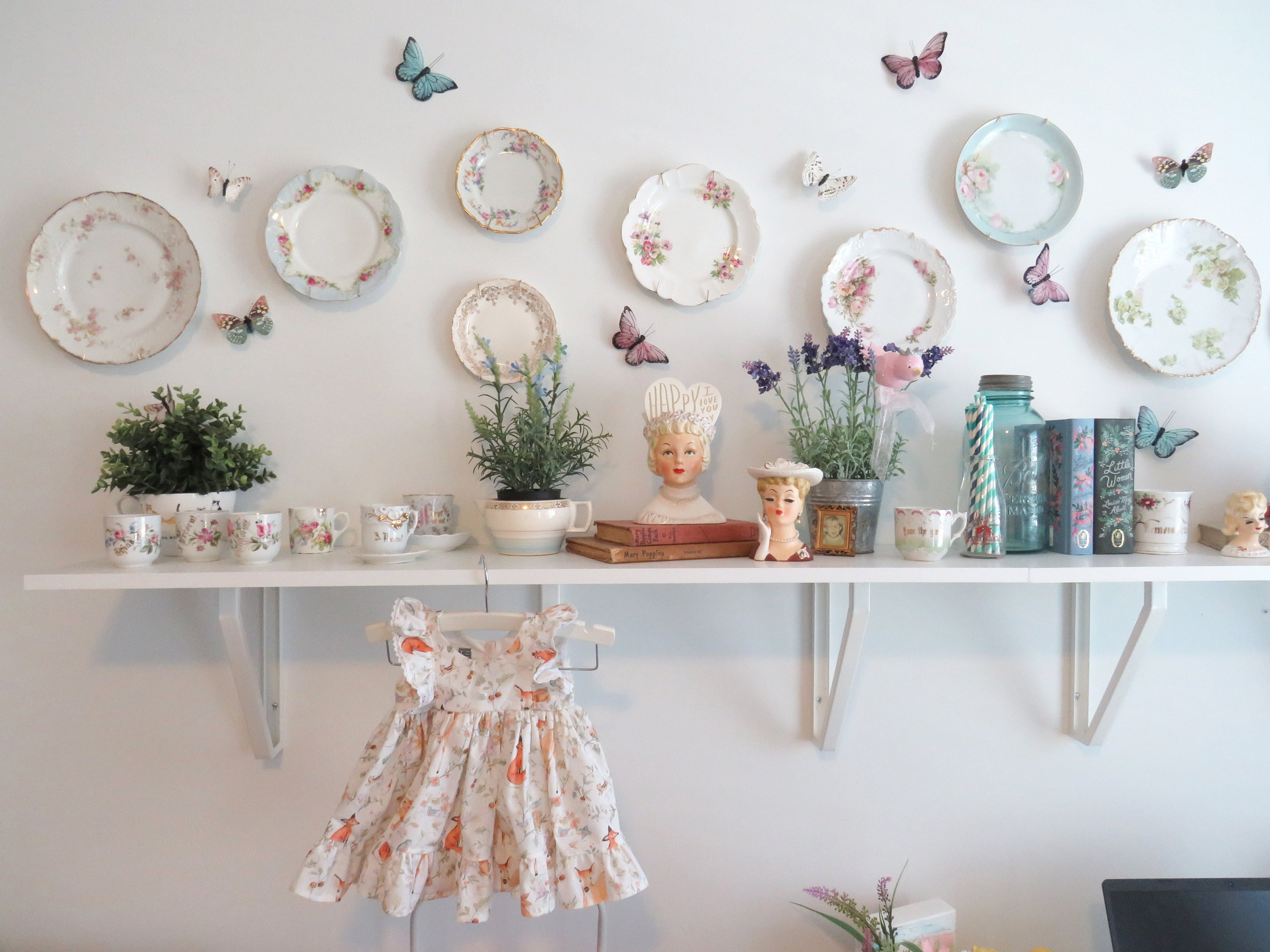 Wall decor with butterflies and baby dress