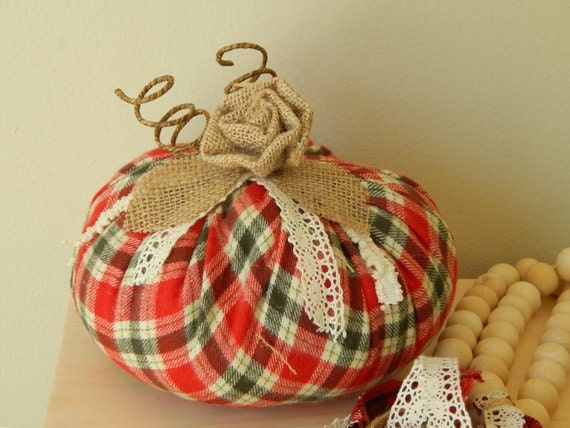Flannel fabric pumpkin with cotton stems.