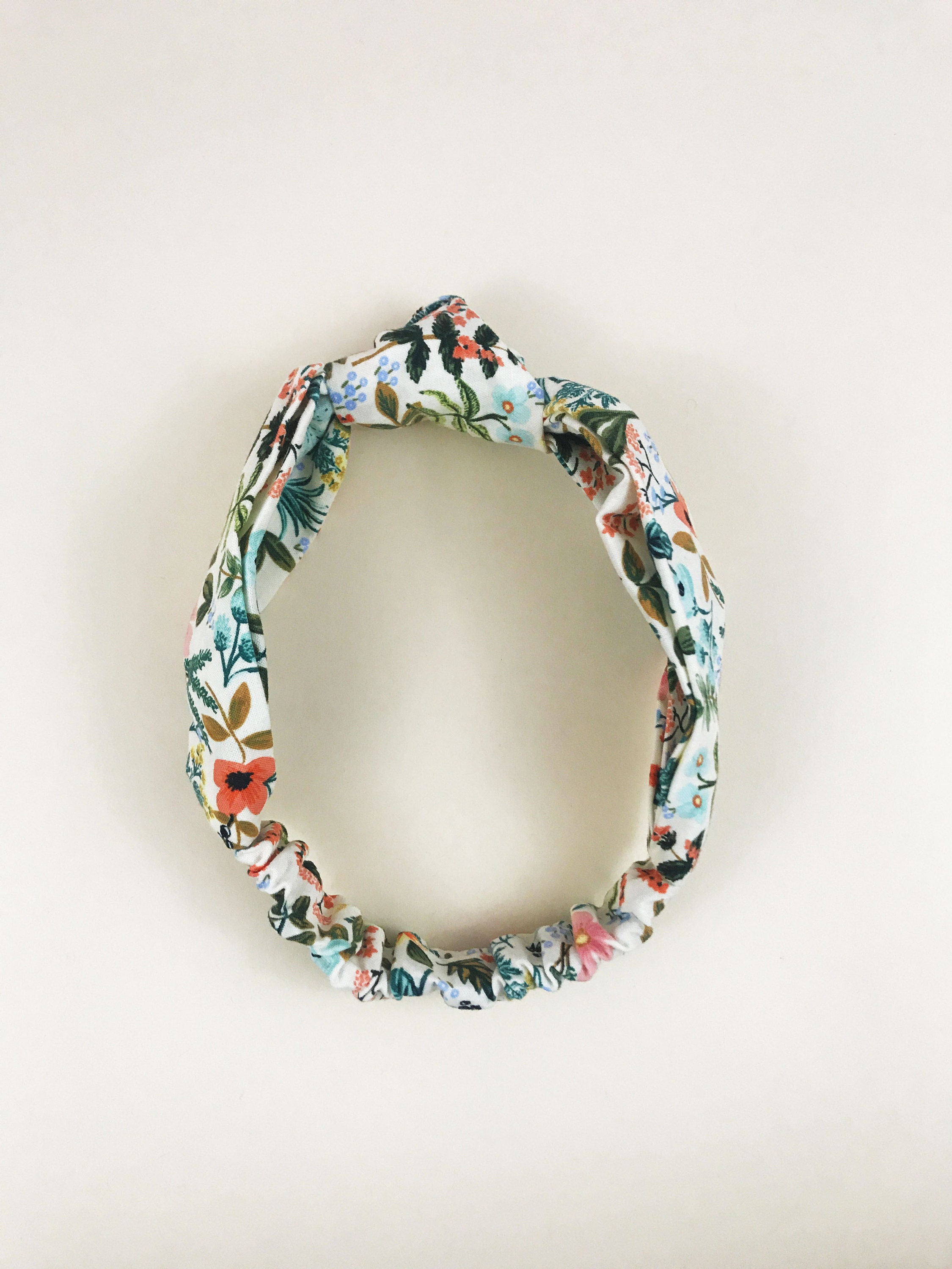 Cream floral knotted headbands.