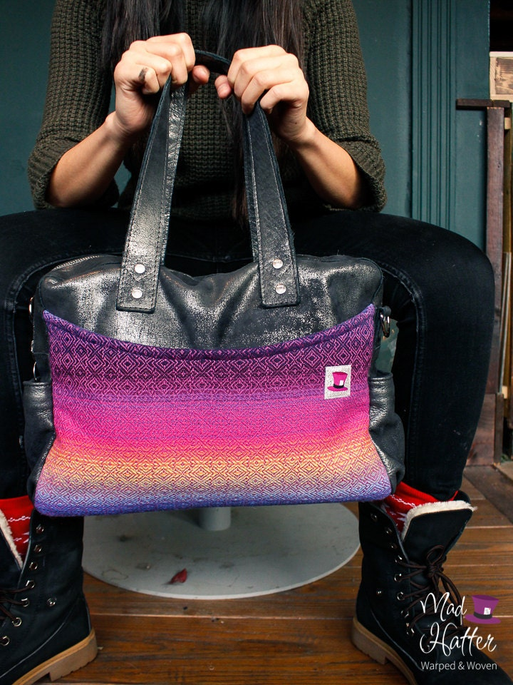 A woman holding a Mad Hatter Warped & Woven Lovato handbag featuring Heartfelt colourway and Silver Foil leather