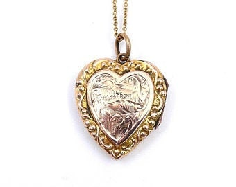 Victorian rose and yellow gold locket with a stamp for 9 carat back and front.