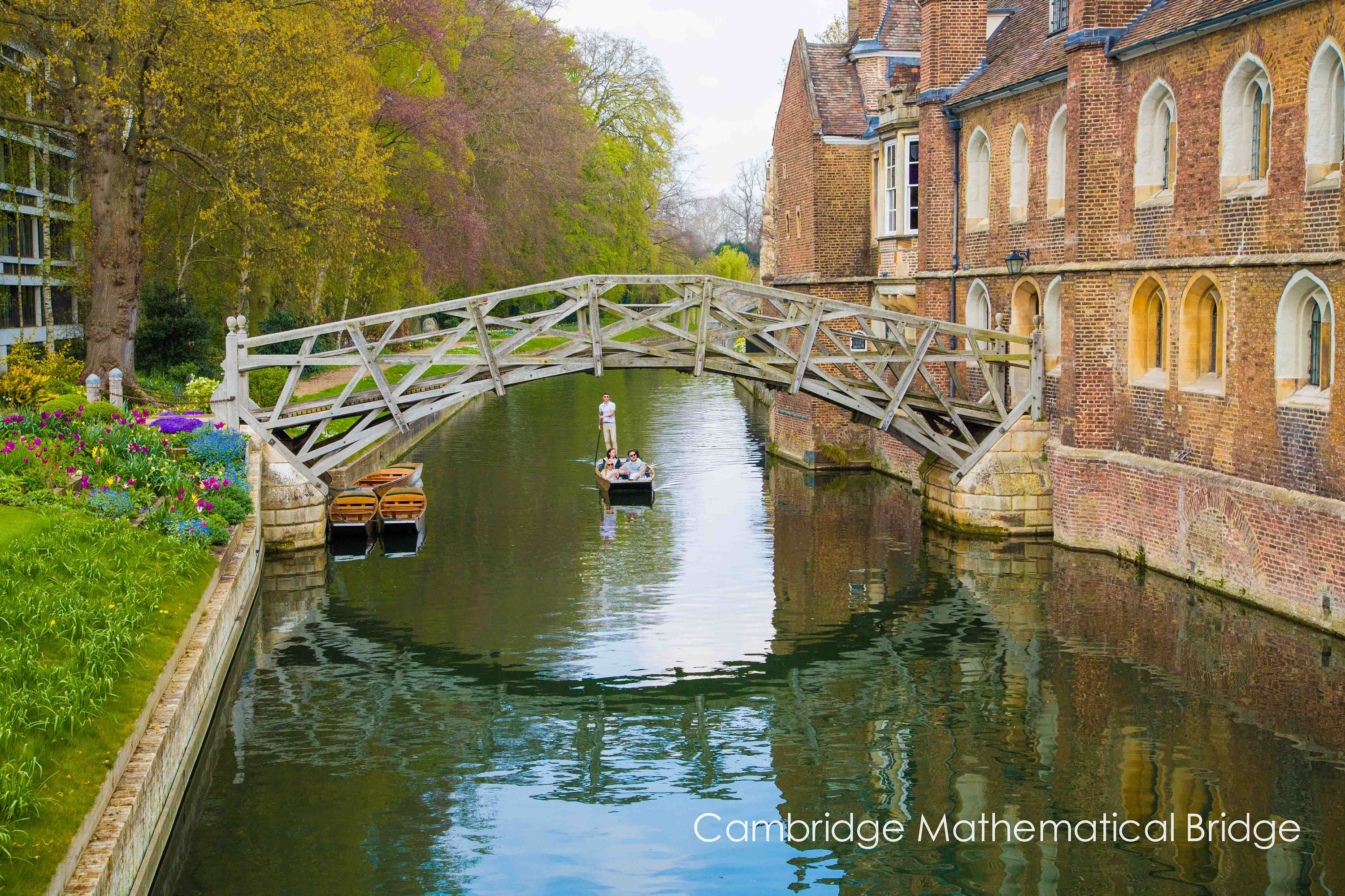 punting on the river cam in Cambridge fine art print showing the mathematical bridge and queens college cambridge university available in a range of sizes and finishes including unframed and ready to hang in colour