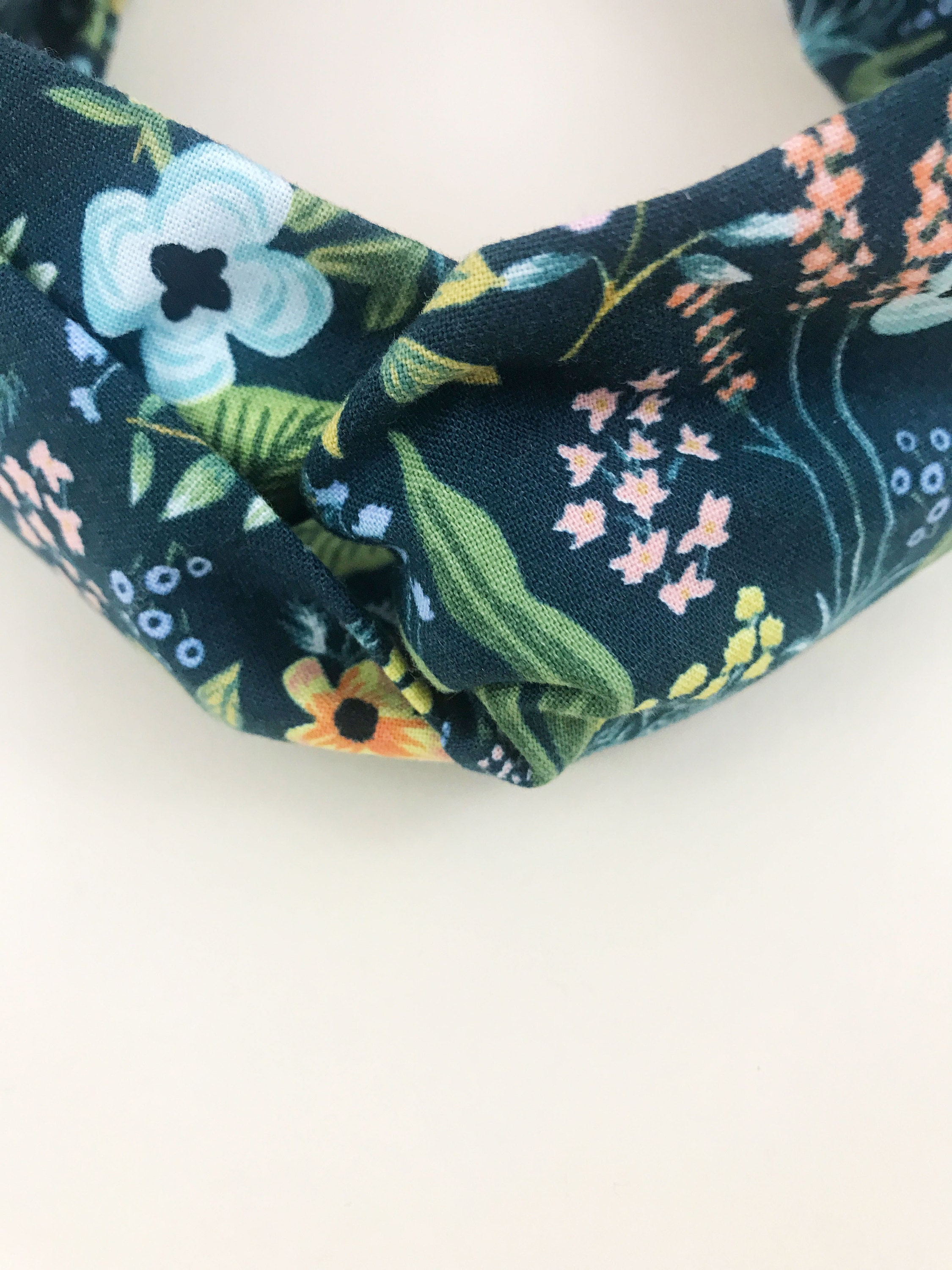 Navy blue floral twisted headbands.
