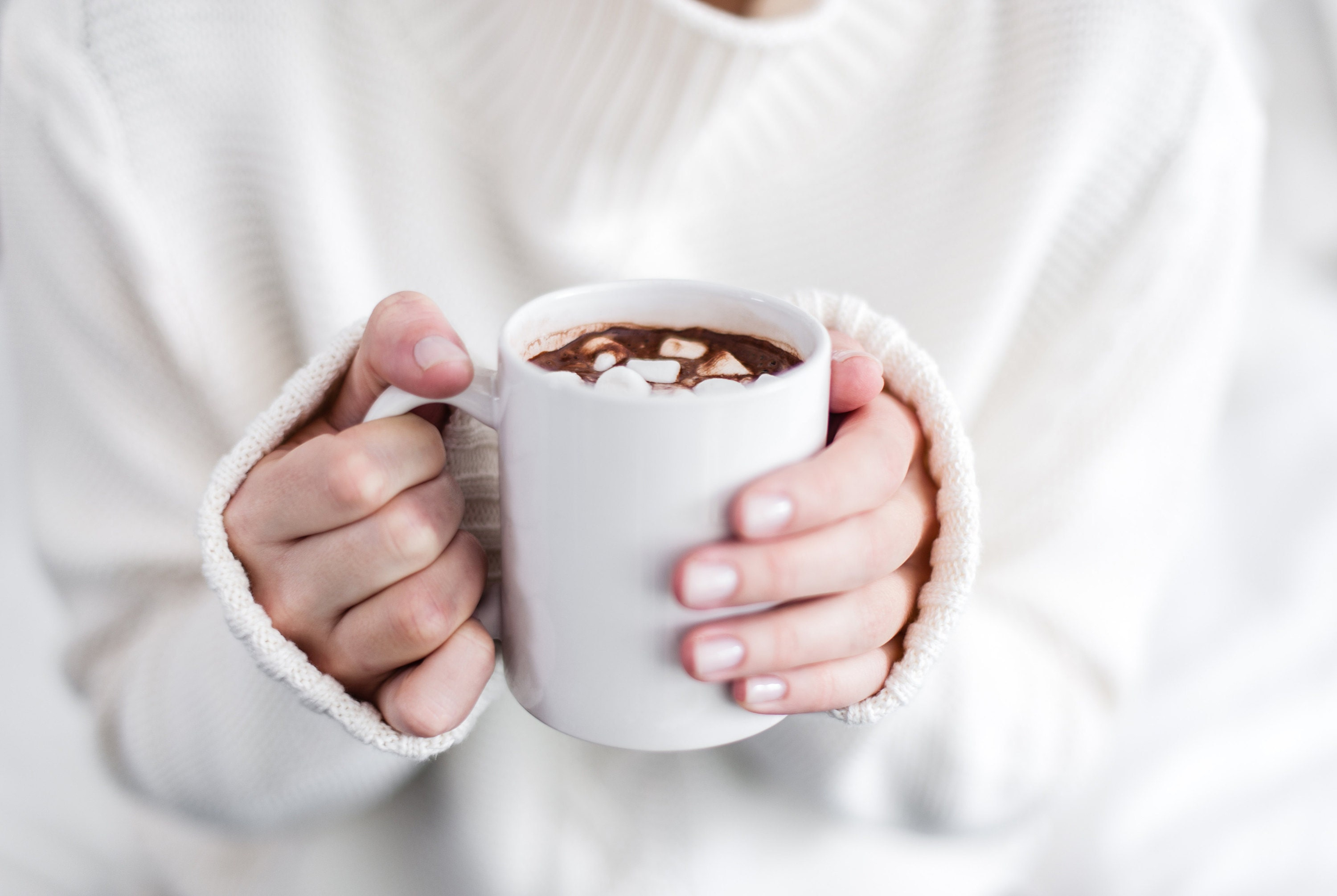 mug of cocoa to plan a baby shower