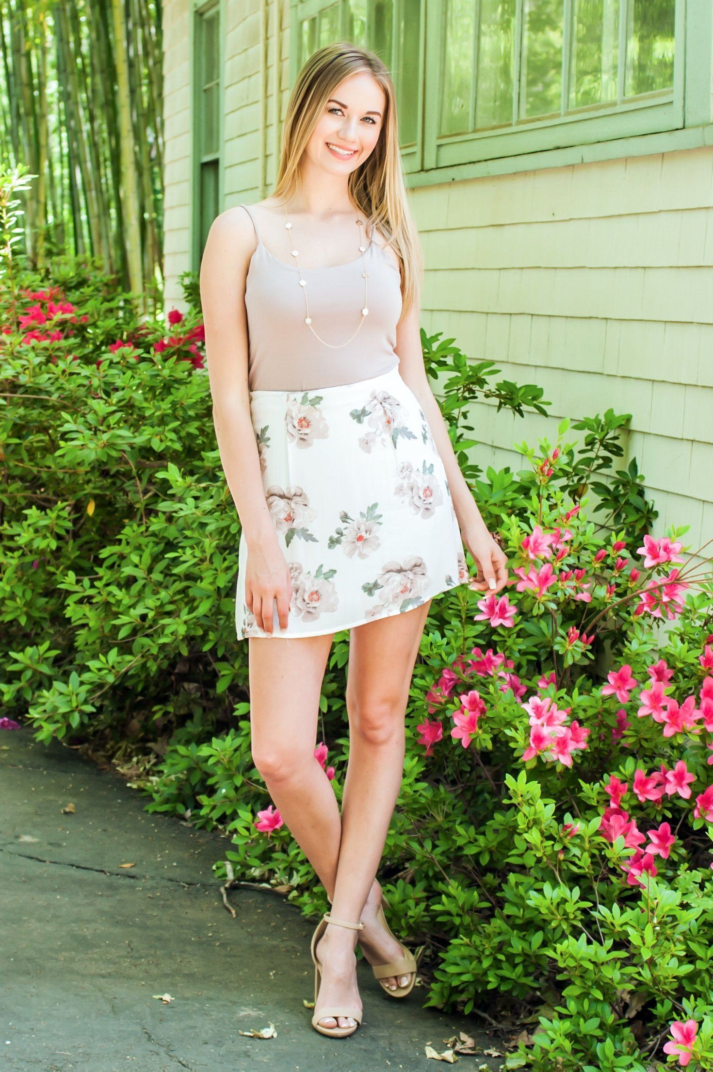 white short skirt on woman for Spring with flowers