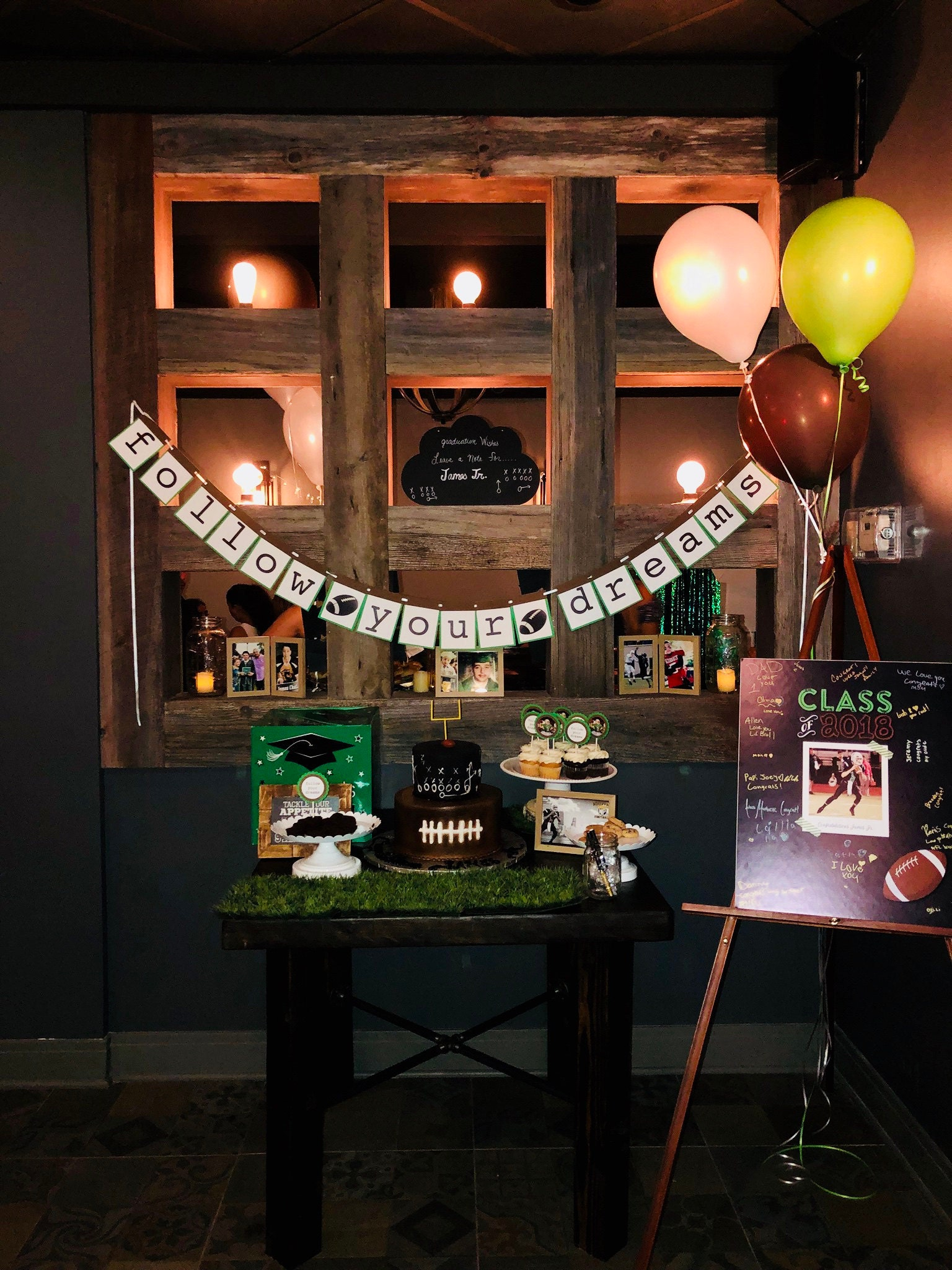 Follow your dreams graduation banner with football decorations and balloons