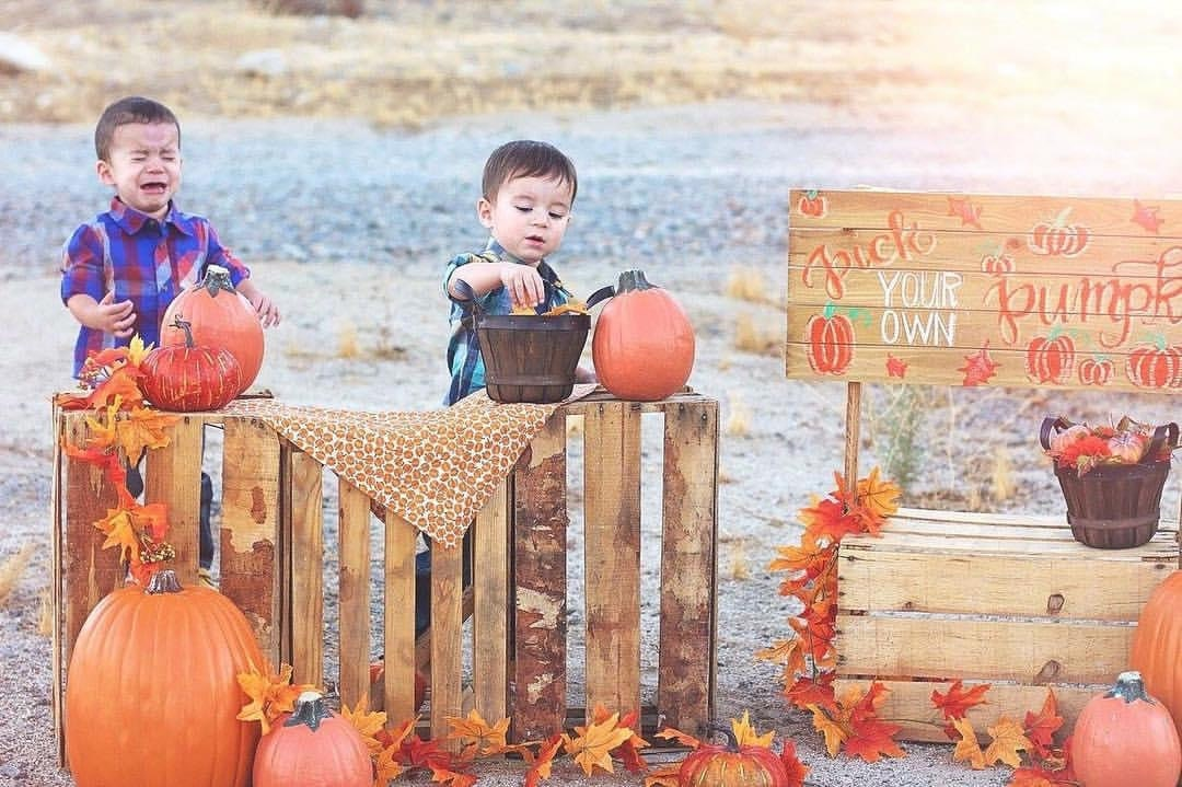 Two kids crying at the pumpkin patch