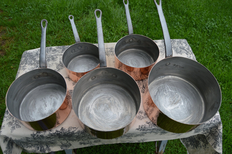 Older tin on a set of pans
