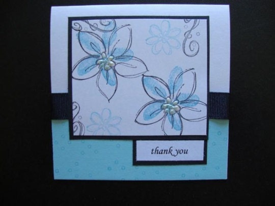 light blue card with black ribbon flowers and thank you