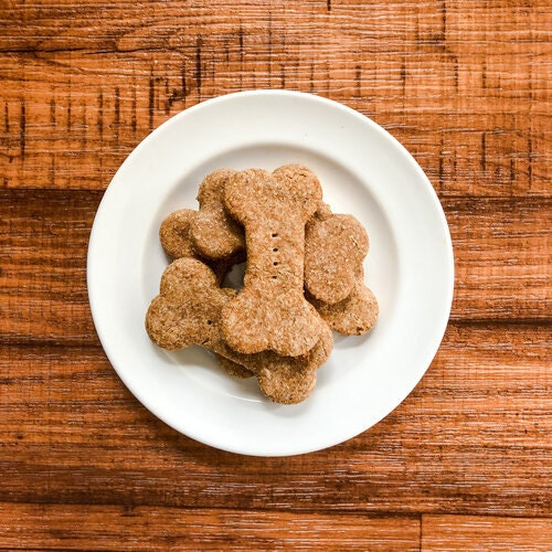 Bone shaped dog biscuits on white plate