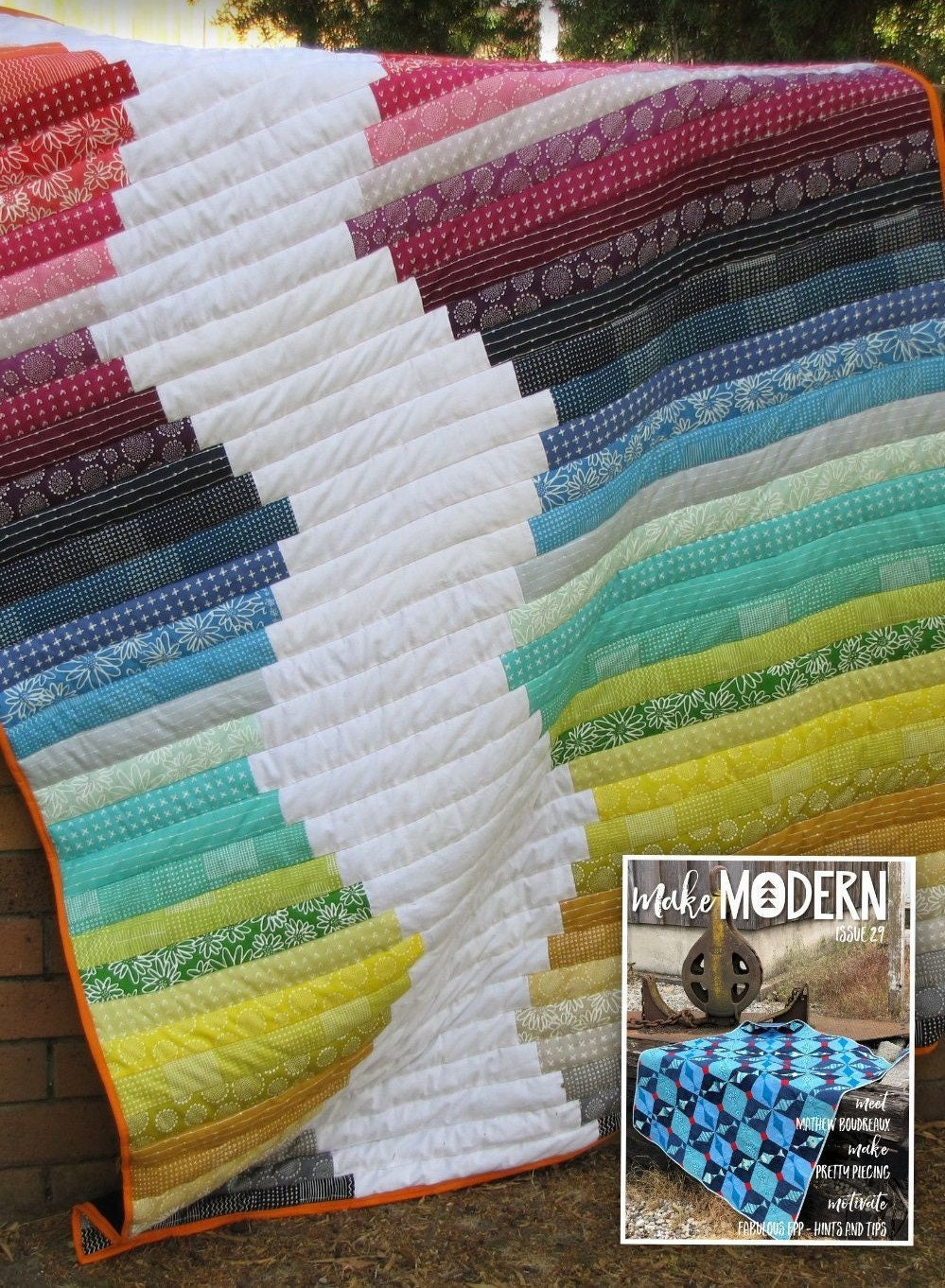 Picture of a quilt draped over a wall. First published by Make Modern Quilting Magazine.