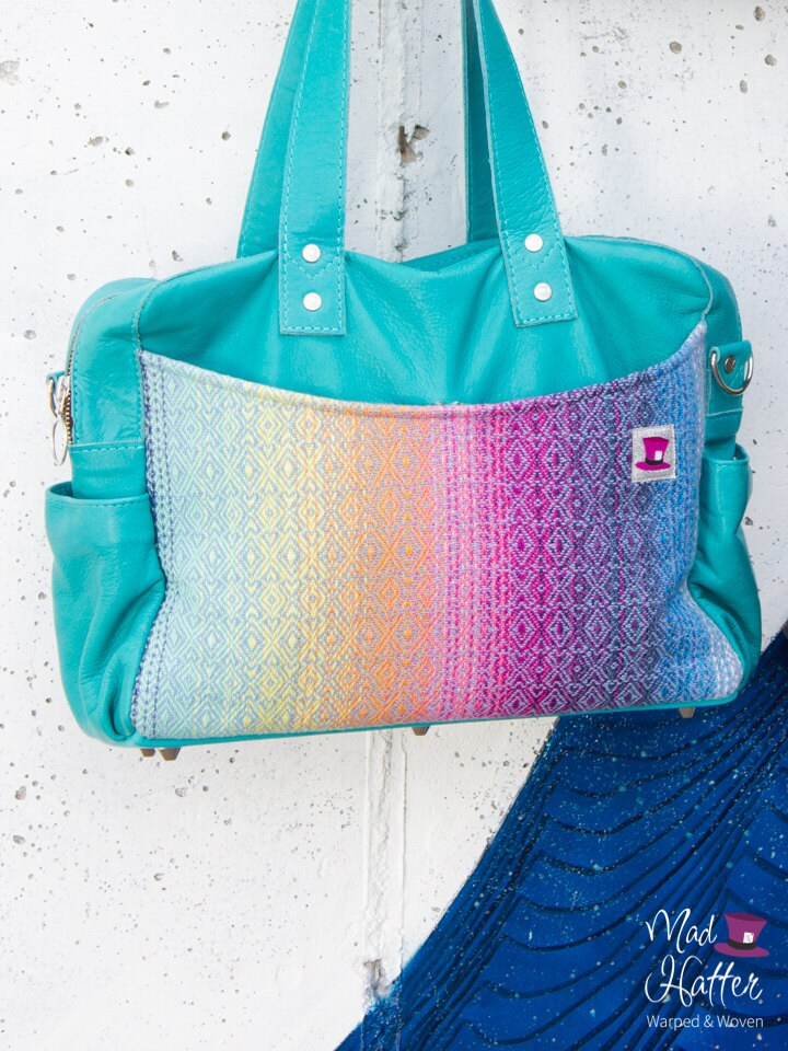 Mad Hatter Warped & Woven Lovato handbag with a rainbow colourway and turquoise leather.