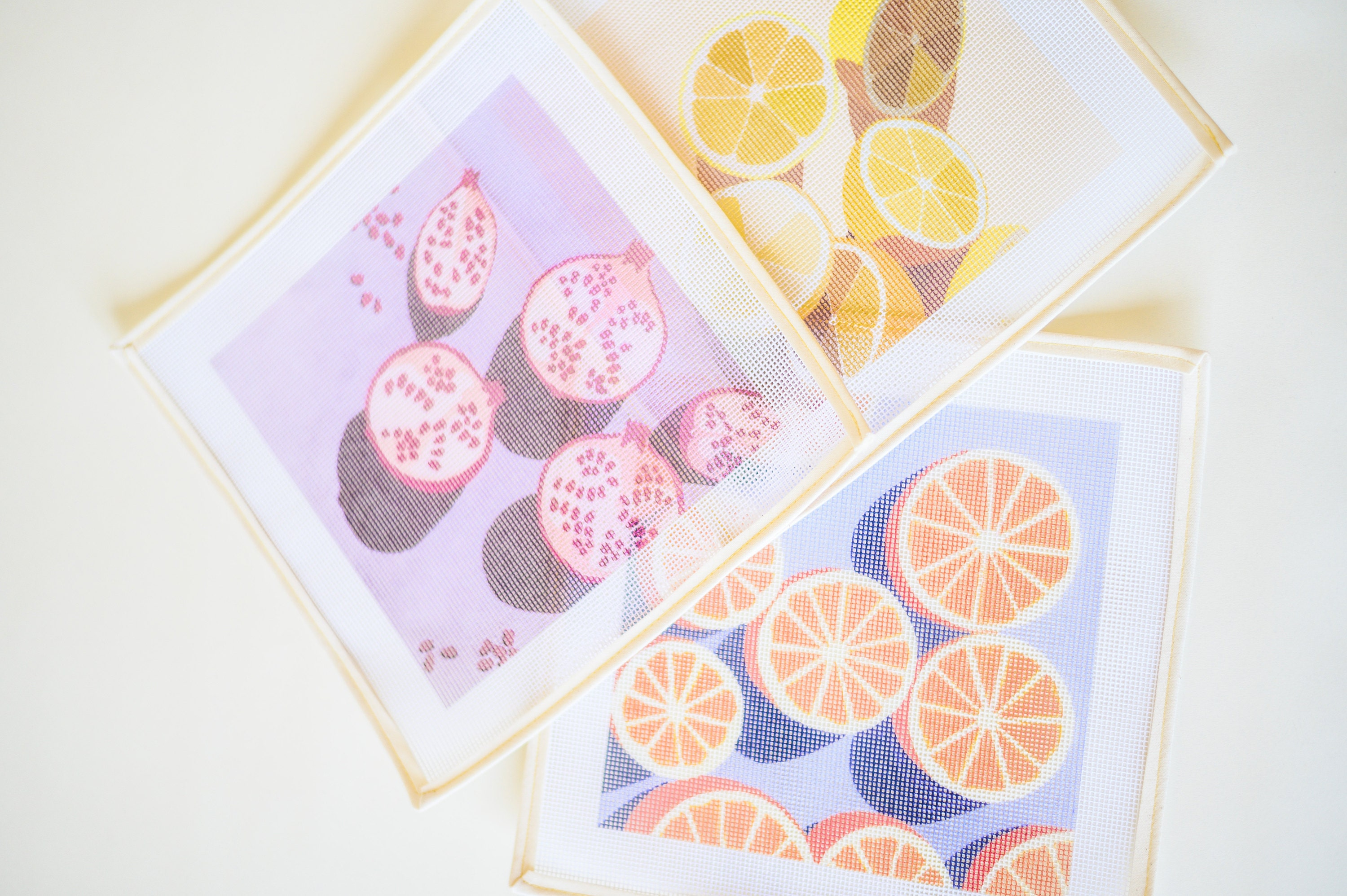 Pomegranates, Oranges and Lemons printed needlepoint canvases from Unwind Studio designed by Laura Croft, Ana Popescu and Anca Putin