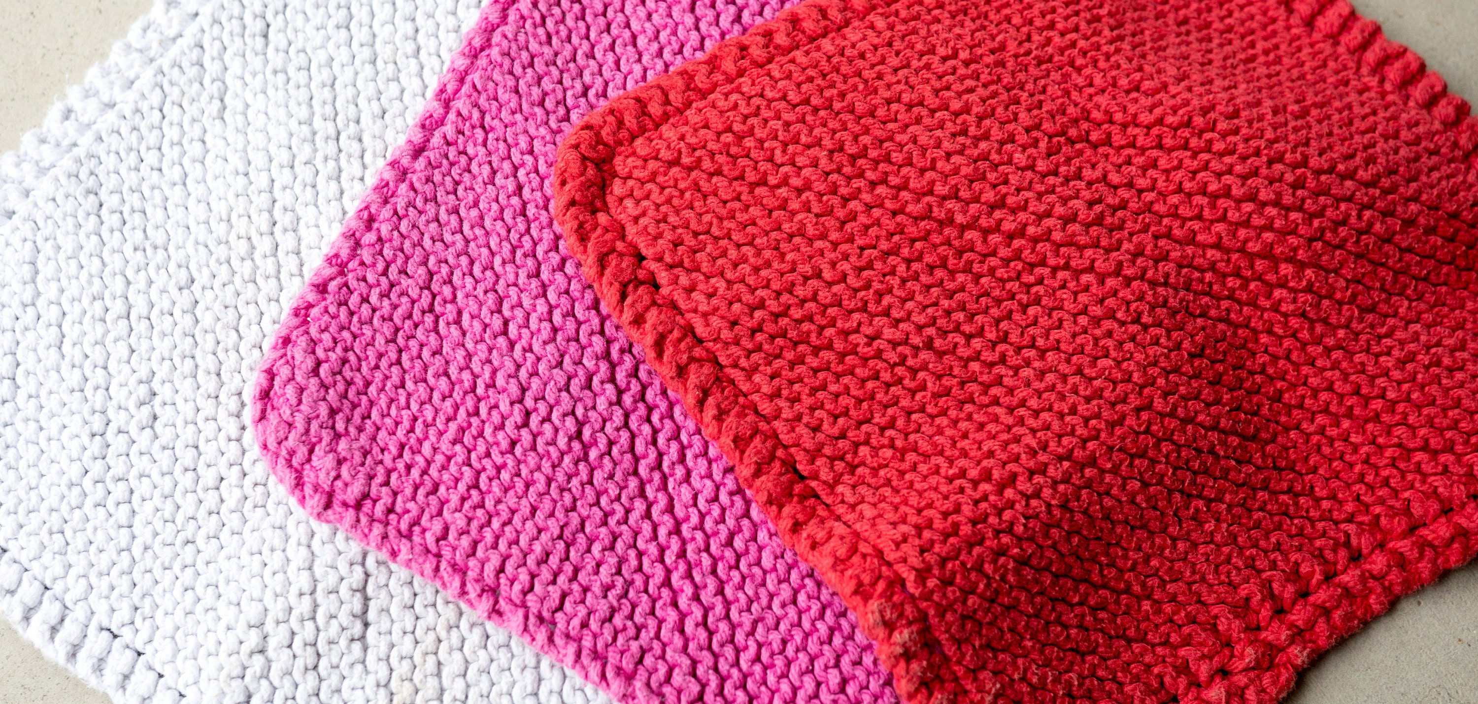 White, pink, and red wash cloths that I have knitted over the years.