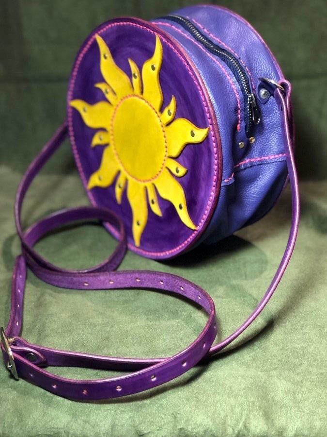 A purple, pink, and yellow purse