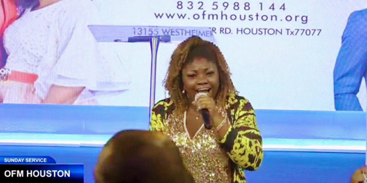 Picture of Rebeccah Worship leading Praise and Worship at Omega Fire Ministries Houston
