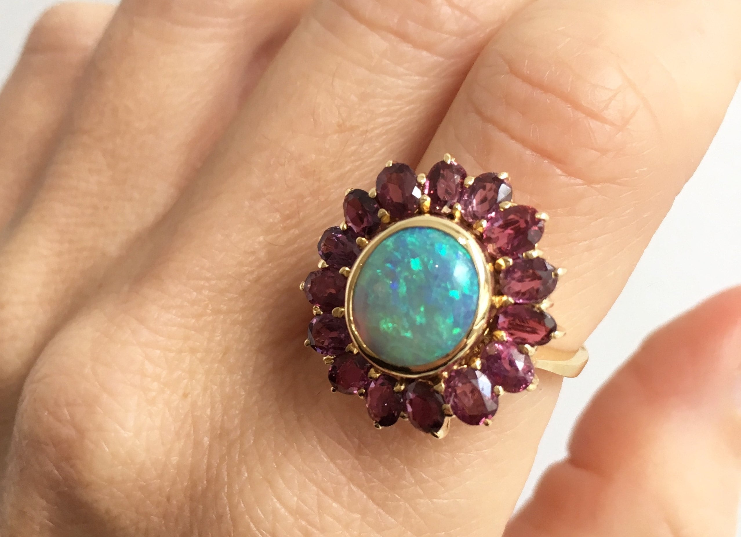 Black-Fiery-Australian-Opal-Ballerina-Ring-gold-rubies-flower-shaped Buffalo Jeweler