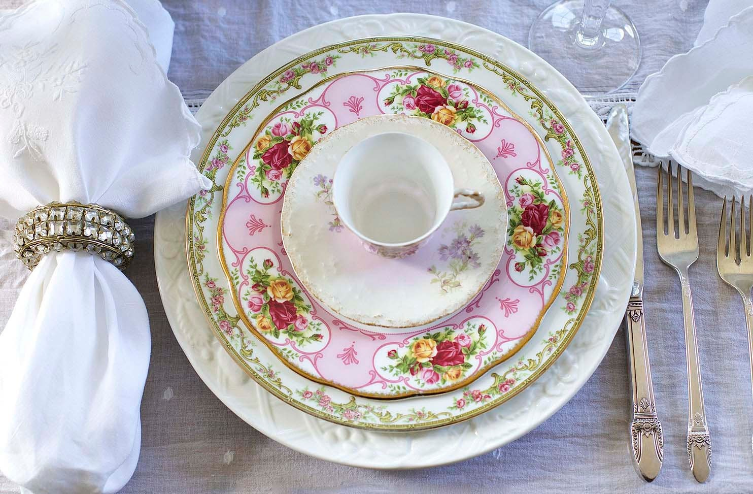 A beautiful and summery tablescape with mismatching china.