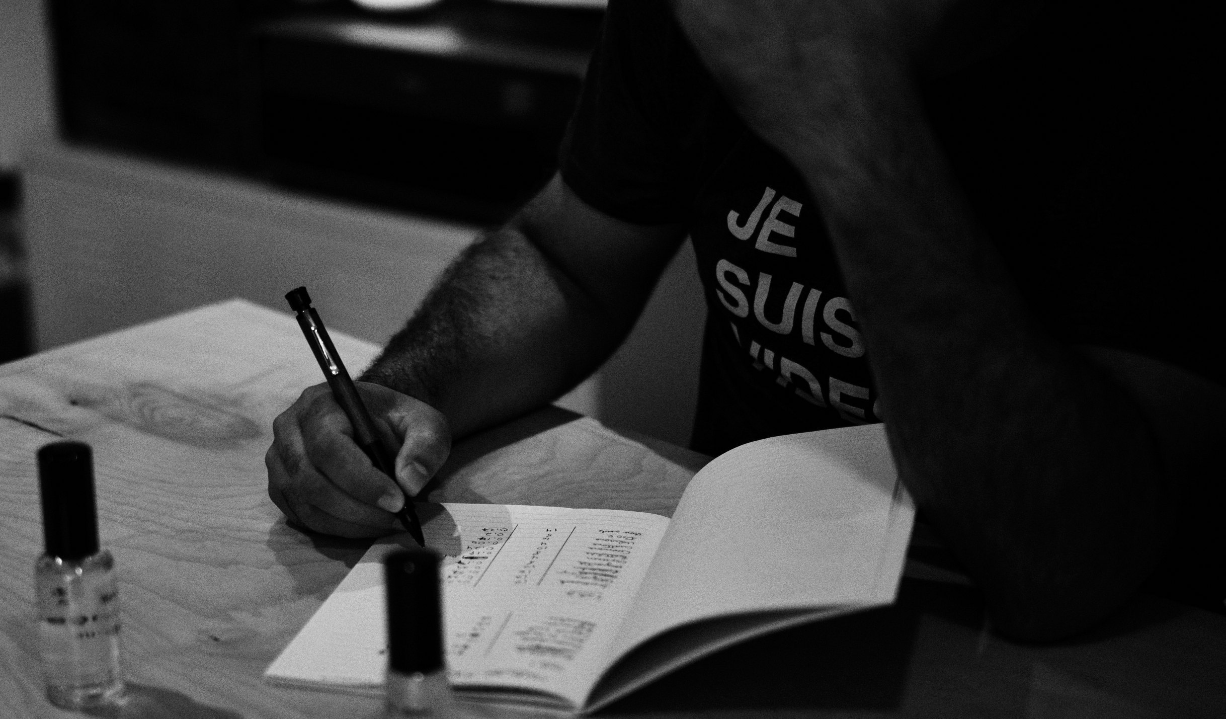 Perfumer Lucien Petipas writing in his notebook