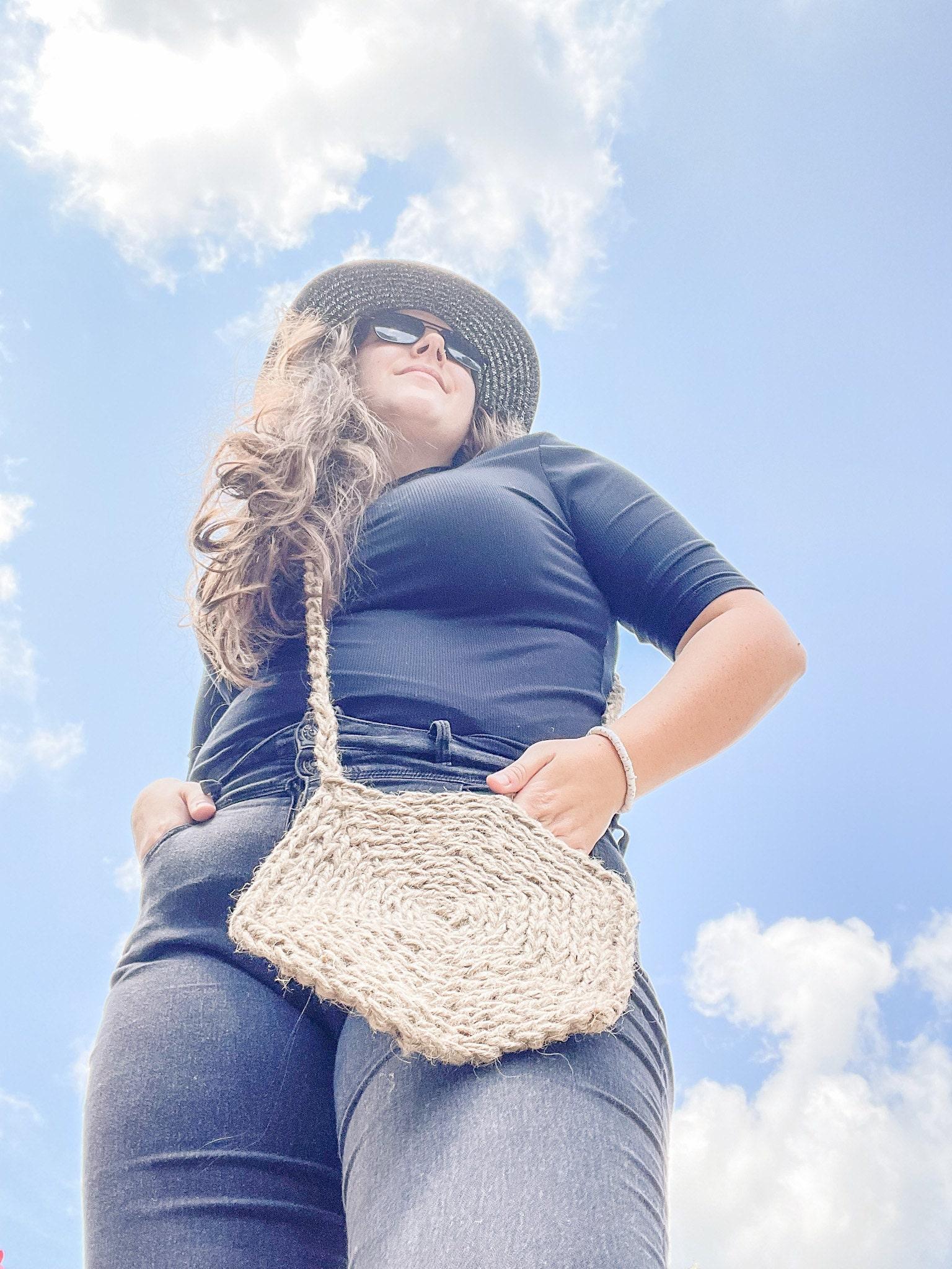 Woman wearing a natural crochet bag