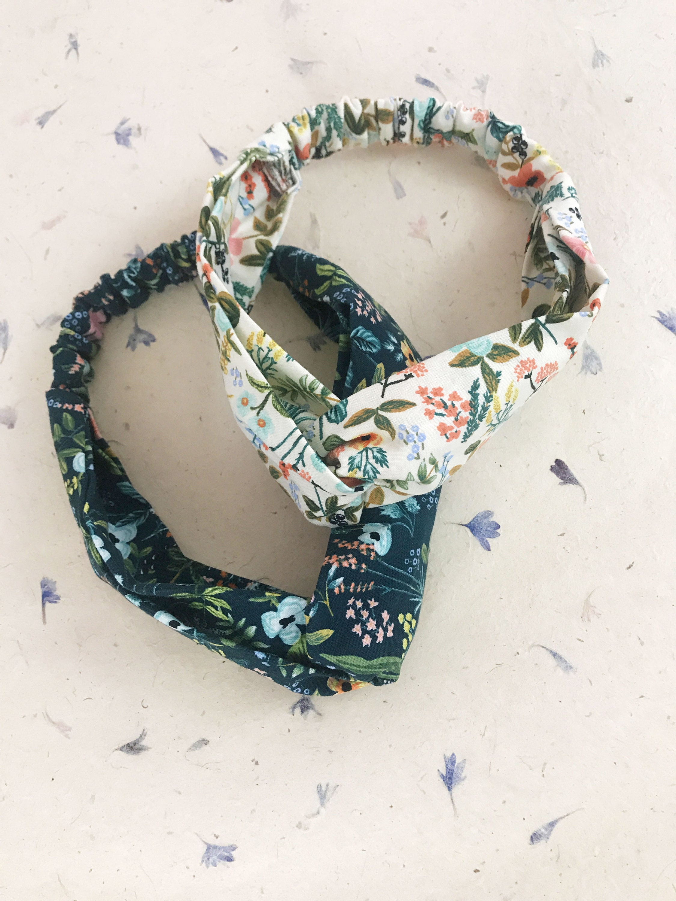 Navy blue and cream floral twisted headbands.