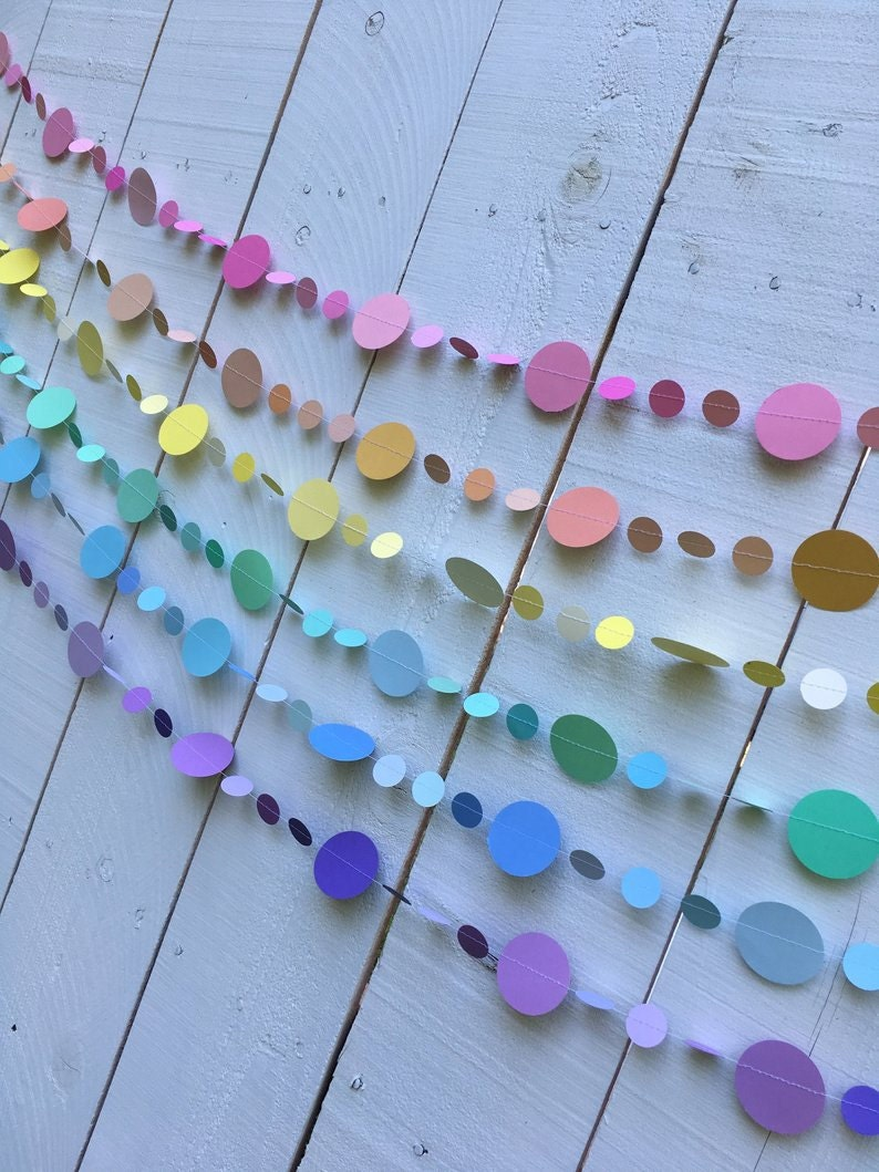 six strands of circle garlands in pink, peach, pale yellow, mint green, light blue, and lavender