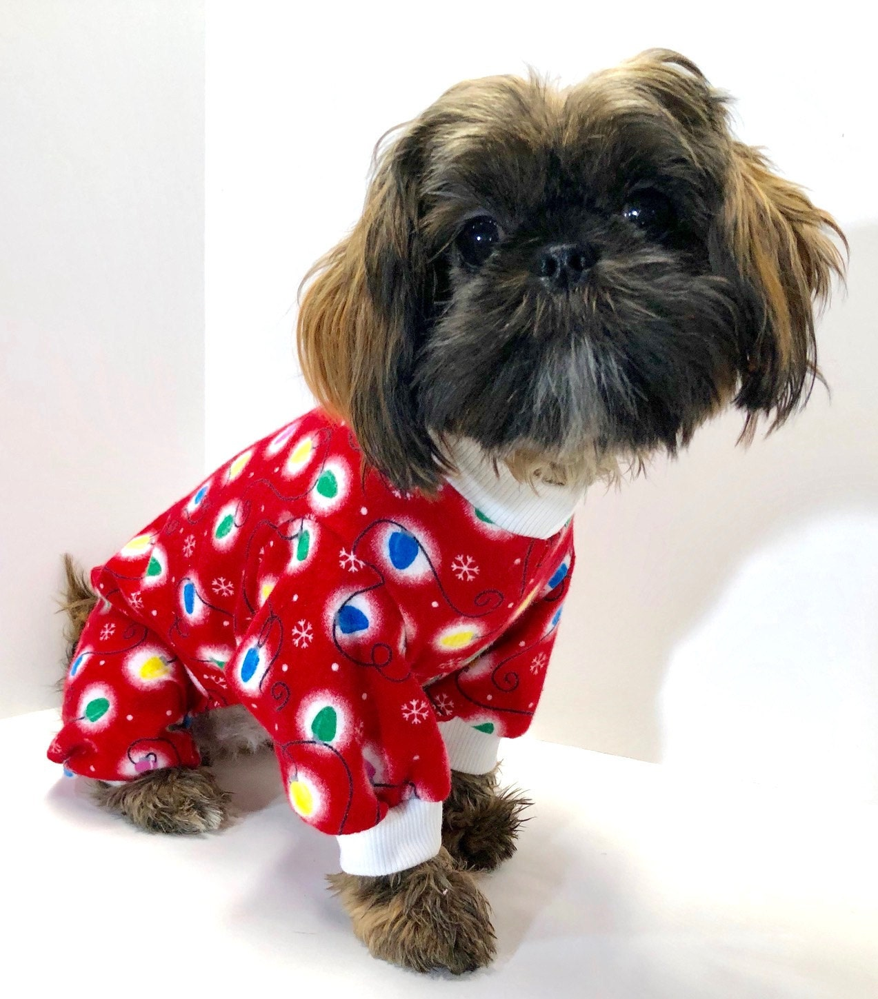 our rescue shih tzu wearing christmas onesie. she is such a sweetheart.