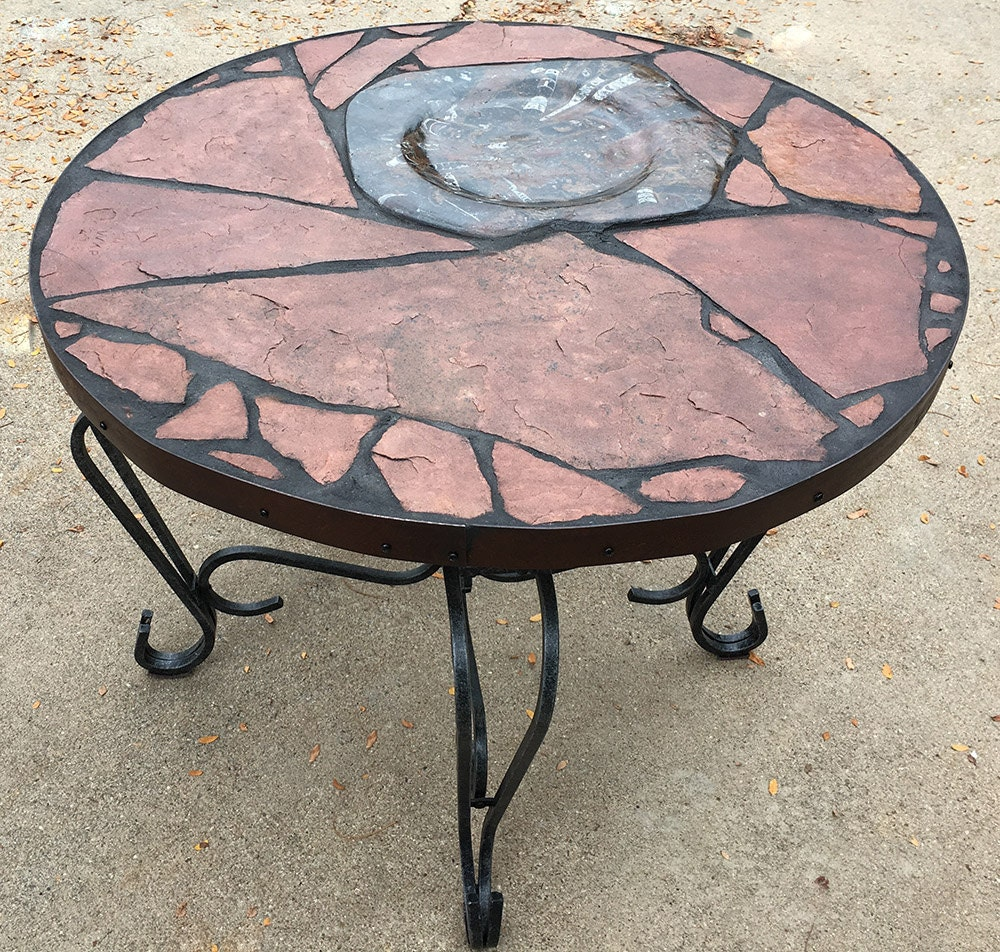 Moroccan Moon 2: A natural stone topped table featuring Moroccan fossils