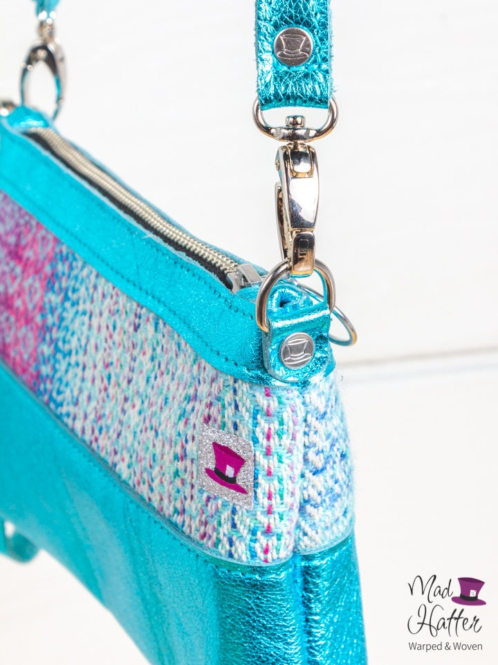Mad Hatter Warped & Woven Hartley handbag featuring Remix colourway and teal metallic leather.