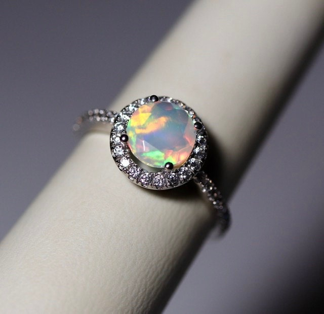 I can't believe that I haven't received a review for these two absolutely amazing opal rings in 14K white gold halo ring setting. The opals were just a dream in both rings.
