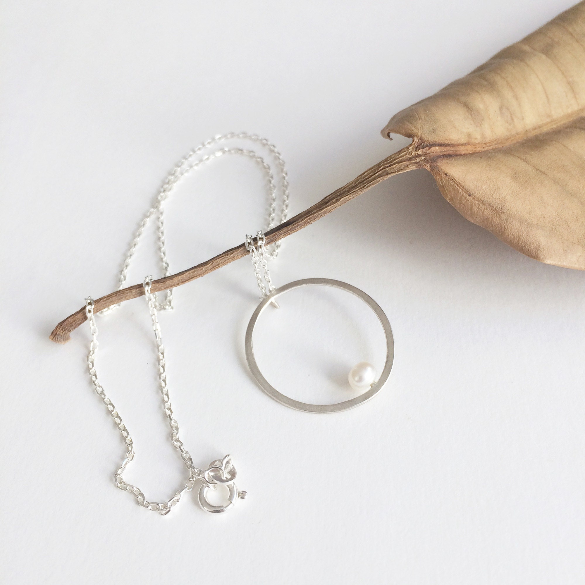 Delicate open circle with pearl necklace