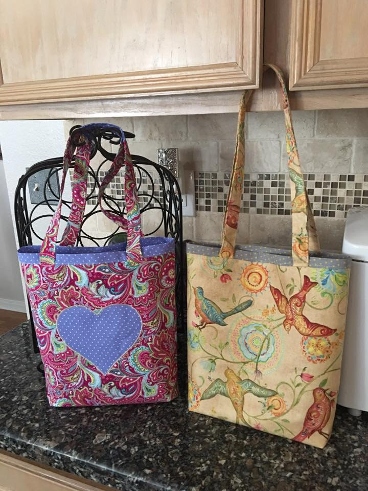 Simple tote bags with constrasting fabric applique.