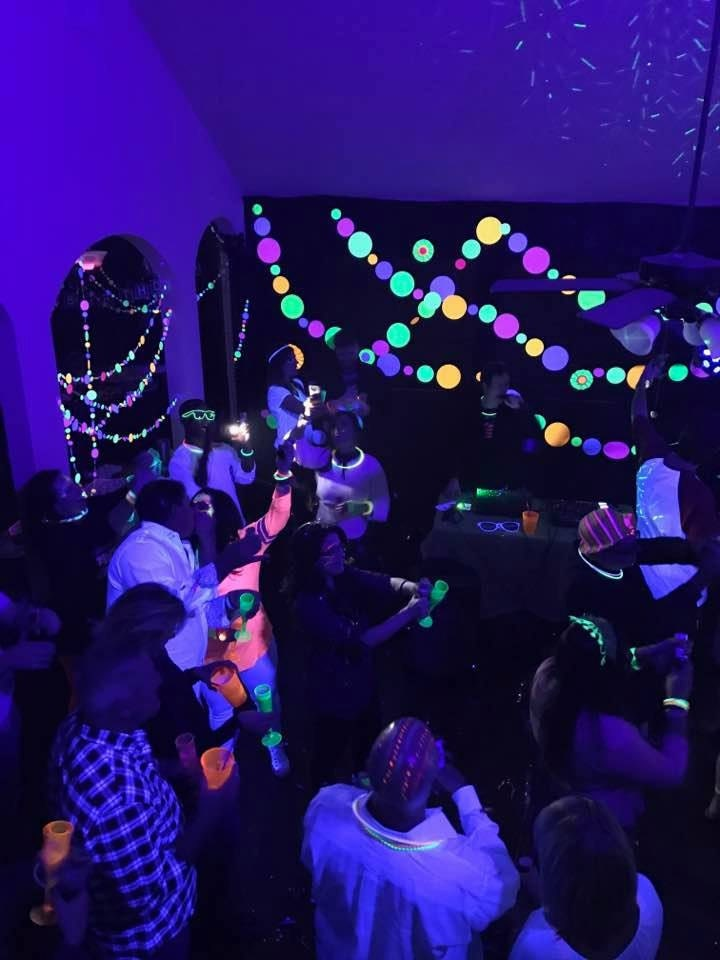 fluorescent large circle garlands in neon colors at a black light glow party