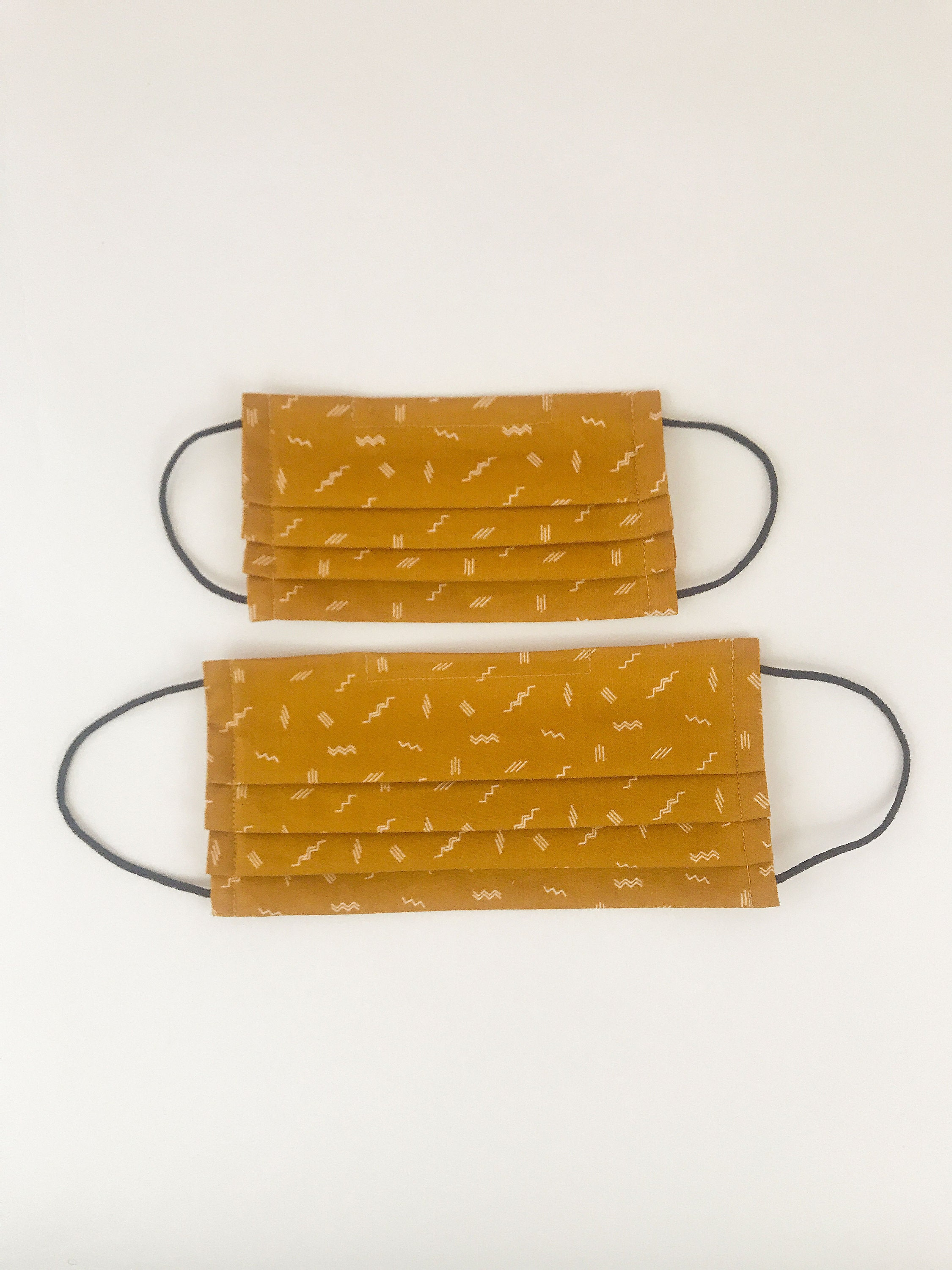 Pleated face masks for adults and children in ochre