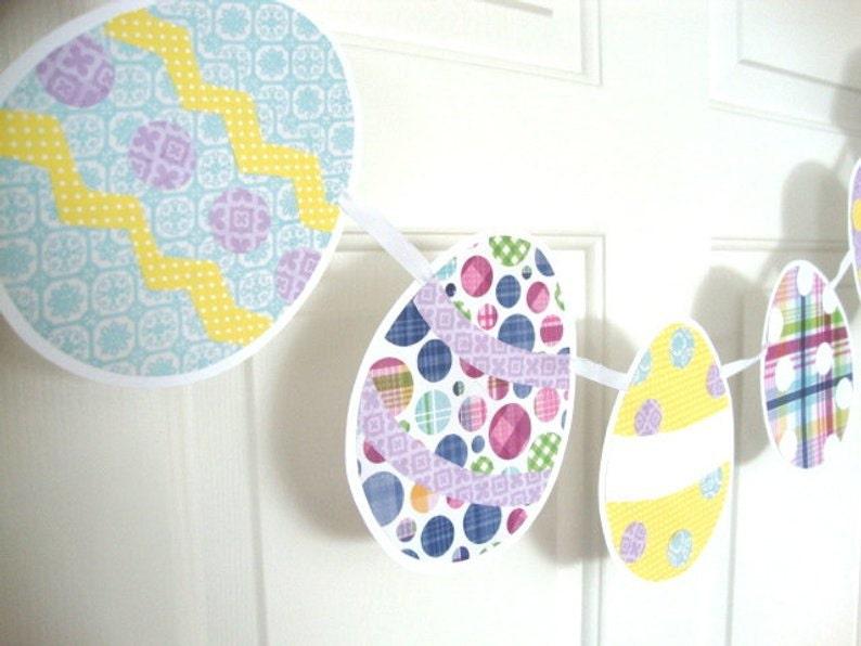 Easter Egg banner in pastel patterned scrapbook paper strung on ribbon