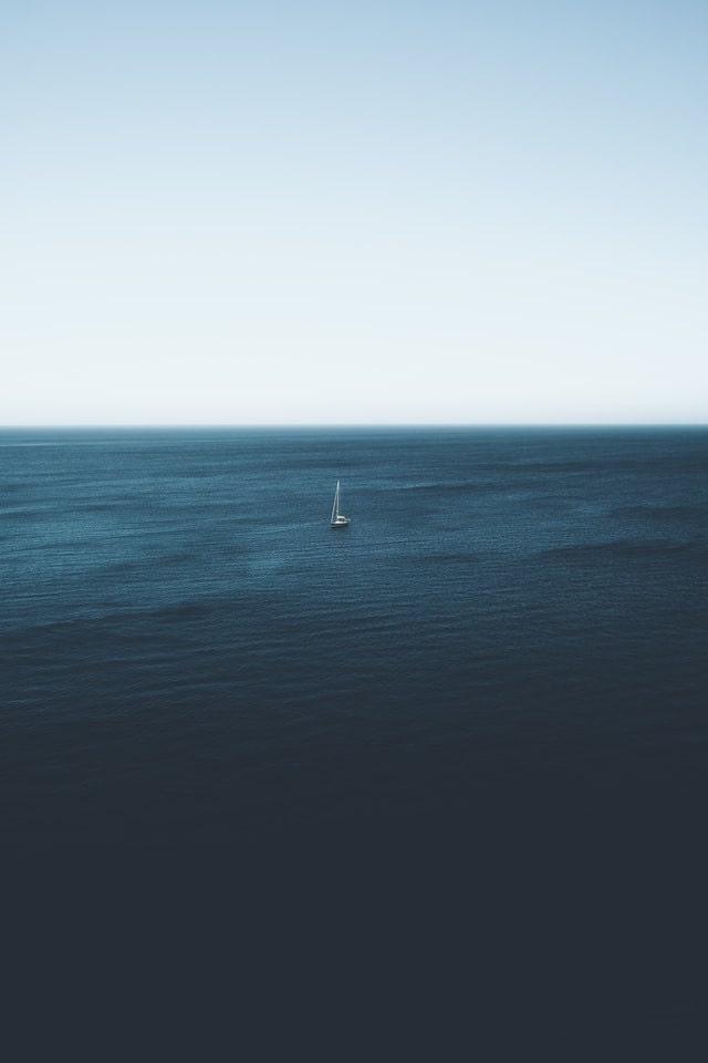 tiny boat big sea