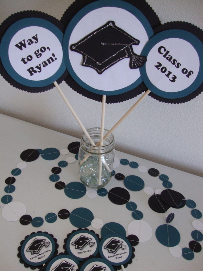 Teal and black graduation centerpiece, garland and cupcake toppers