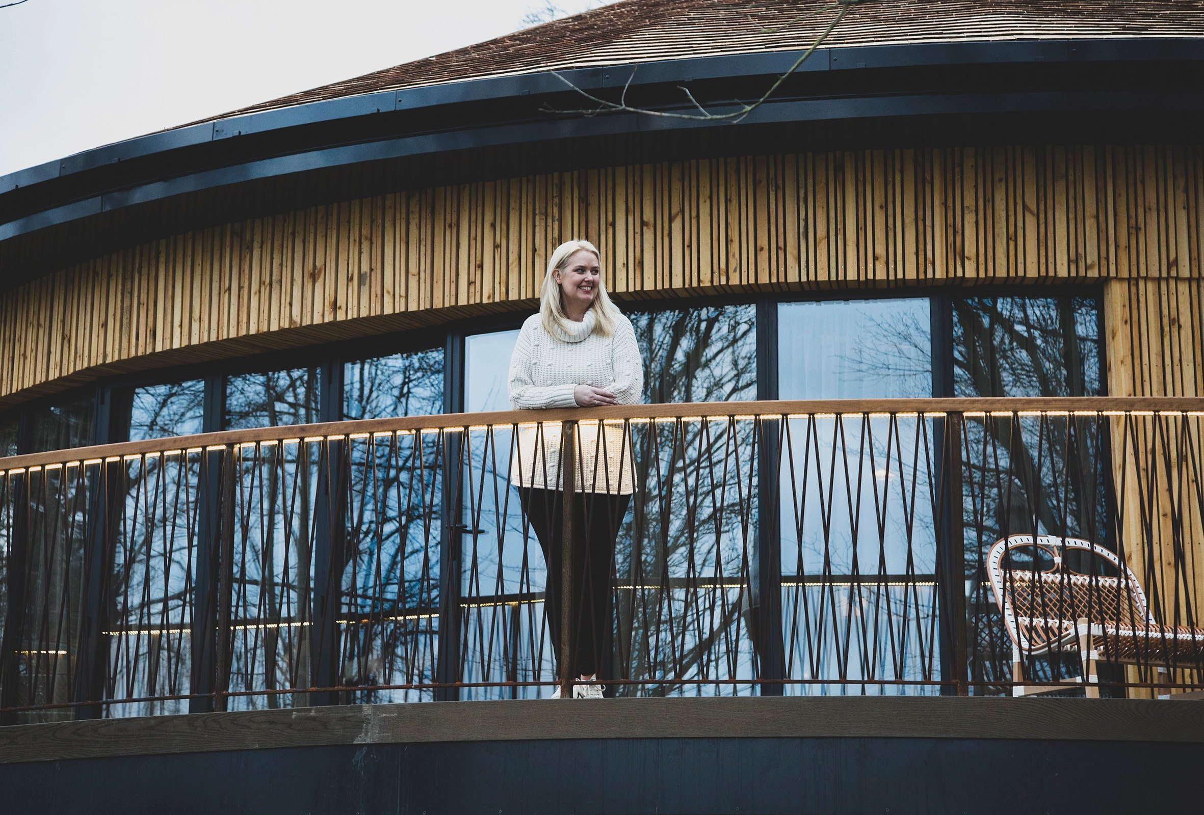 Louise standing on the balcony of the treehouse