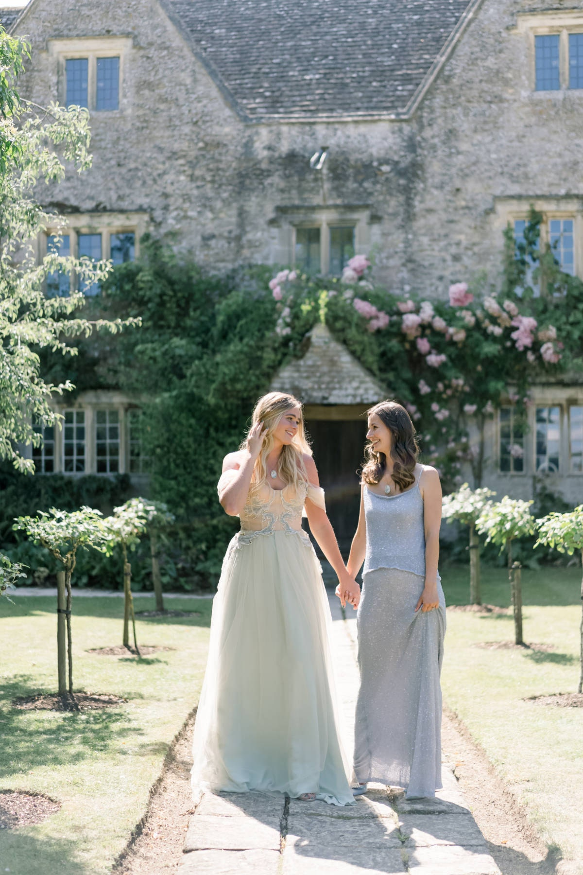 Bride & Bridesmaid wearing custom wedding dress fabric necklaces.