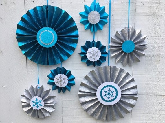 Turquoise, teal and silver glitter hanging medallions for a Frozen-themed or winter party