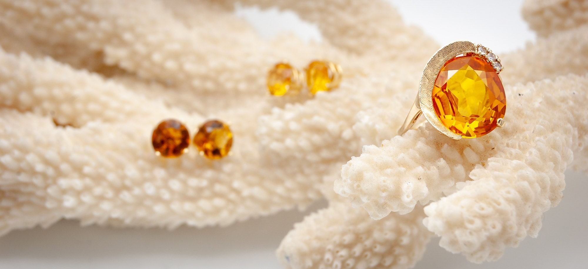 Citrine-Gold-Deco-Ring-Earrings-on-Coral